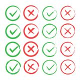 Tick and cross brush signs. Green checkmark OK and red X icons, isolated on white background. Simple marks graphic Stock Image