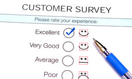 Tick in excellent checkbox on customer service satisfaction survey form.  royalty free stock image