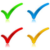 Tick Icons. A set of four glossy tick/check mark icons in varying colors Stock Photography