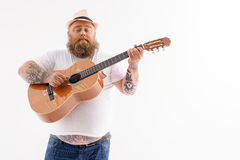 Tick male guitarist creating music Stock Images