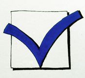 Tick mark. Blue hand-drawn tick mark Royalty Free Stock Photo