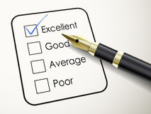 Tick placed in excellent check box with fountain pen Royalty Free Stock Photos