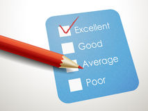 Tick placed in excellent check box with red pen Royalty Free Stock Photo