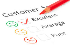 Tick placed in excellent checkbox on customer serv stock photo