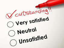 Tick placed in outstanding check box with red pen Royalty Free Stock Photo