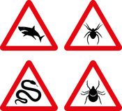 Tick, snake, shark and spider warning signs Royalty Free Stock Photo