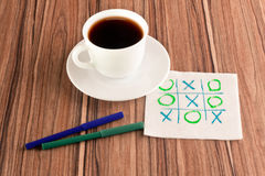 Tick-tack-toe on a napkin Stock Photos