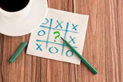 Tick-tack-toe and question mark on a napkin Royalty Free Stock Photography