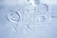 Tick-tack-toe on the snow Royalty Free Stock Photos