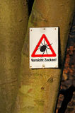 Tick warning. A tick warning sign at a bole in Germany vector illustration