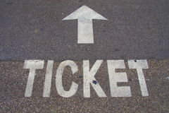 Ticket and arrow. Road marking - Ticket and arrow stock images