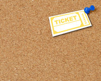 Ticket attached to corkboard Stock Photos