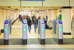 Ticket barriers at the Centraal railway station in Amsterdam. AMSTERDAM - APRIL 16: Ticket barriers at the Amsterdam Centraal railway station on April 16, 2015 Royalty Free Stock Photo