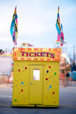 Ticket Booth. Yellow ticket booth decorated with balloons and flags Royalty Free Stock Photos