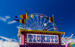 Free Ticket Booth And Rides At A Carnival Against Blue Sky Stock Photo - 60718750