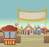 Ticket booth on the entrance of a retro cartoon circus. With tents. Vintage carnival background royalty free illustration