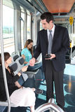 Ticket collector in tramway Royalty Free Stock Photography