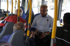 TiCKET CONDUCTOR CHECKING TIKCETS. Copenhagen /Denmark - 12 June 2017.    Tiket conductors checking transport ticket, bus line 4A and 5C bus driver does not Royalty Free Stock Image
