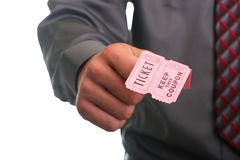 Ticket with coupon. The businessman in a grey shirt and a tie stretches the ticket with the coupon Stock Photo
