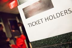 Ticket holder sign posted on the wall of the entrance. Ticked holder sign posted on the wall to guide people where to go Stock Image