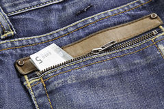 Ticket in jeans Stock Images