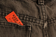 Ticket in jeans pocket Royalty Free Stock Photos