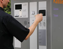 Ticket machine. Man paying for his parking ticket Royalty Free Stock Photos