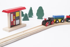 Ticket machine at railroad track. Toy ticket machine at wooden railroad track with some trees in background Stock Photo