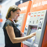 Ticket Machine. Young woman paying at ticket machine in a metro station Royalty Free Stock Photography