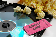 Ticket and movie. Ticket stub and popcorn with DVD closeup Stock Images