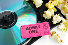 Ticket and movie. Ticket stub and popcorn with DVD closeup Stock Image