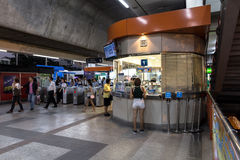 Ticket office corner at BTS Mo Chit station at night. Bangkok, Thailand - January 18, 2016 : Ticket office at the BTS Mo Chit station at the evening with 2 stock images