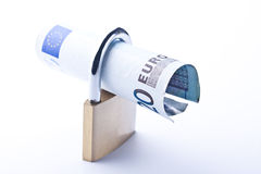 Ticket padlock on currencies Stock Photography