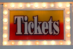 Ticket Sign. In lights. Sign is Yellow and orange in color. Letters in white Stock Images