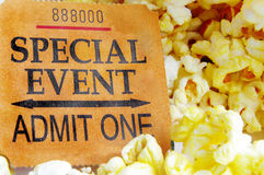 Ticket stub. Special event ticket stub and popcorn closeup Royalty Free Stock Photo
