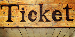 Ticket Text wood sign. Ticket Text engraved on the wood sign Stock Photography