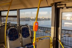 Ticket validator in a modern city bus. Contactless fare in transport royalty free stock photos