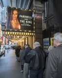 Ticketholders Line up for a Broadway Show. Unseasonably mild temperatures made it an easy task to get in line at a Broadway theatre to see a Wednesday matinee on royalty free stock photography