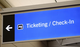 Ticketing, Check-in, and Passenger pick-up sign. Concept of travel Royalty Free Stock Photos