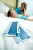 Tickets on bed Royalty Free Stock Photography