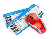 Tickets and computer mouse. Airline tickets and computer mouse Royalty Free Stock Images