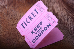 Tickets and coupon. For a pink cardboard for visiting of show, concerts etc royalty free stock photos