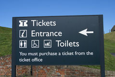 Tickets, entrance, and toilets sign Stock Images