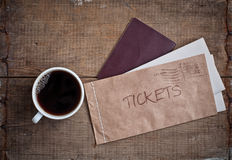 Tickets in envelope, passport and coffee Royalty Free Stock Images