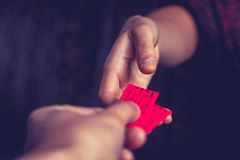 Tickets exchanging hands Royalty Free Stock Photos