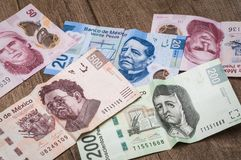 Tickets of 20, 50, 200 and 500 mexican pesos seem to be sad. Stock Photography
