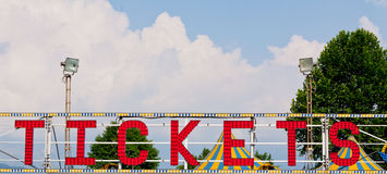 Tickets neon sign in the daylight Royalty Free Stock Photography