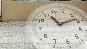 Ticking clock over busy street stock footage