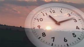 Ticking clock over sunset. Digital animation of Ticking clock over sunset stock footage