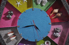 Ticking the colorful clock Stock Image